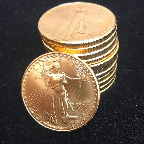 Stacking Twelve 1 oz American Gold Eagle Bullion Coins
