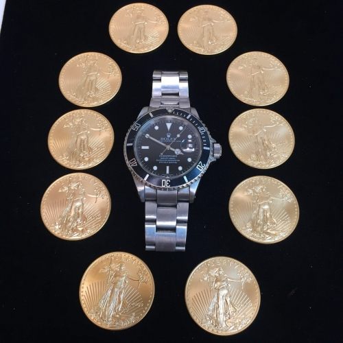 Ten 1 oz American Gold Eagle Bullion Coins Around A Mens Stainless Submariner Rolex Watch